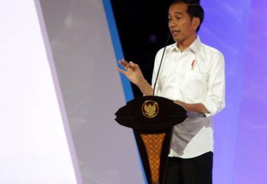 Presiden Jokowi saat beikan wejangan kepada caleg Perindo.