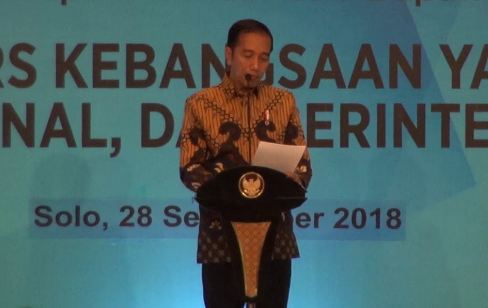 Presiden Jokowi saat pidato dalam Kongres XXIV PWI di Solo.