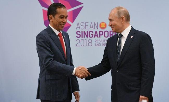 Presiden Jokowi dan Vladimir Putin.