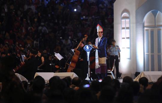Presiden Jokowi saat berikan kata sambutan.