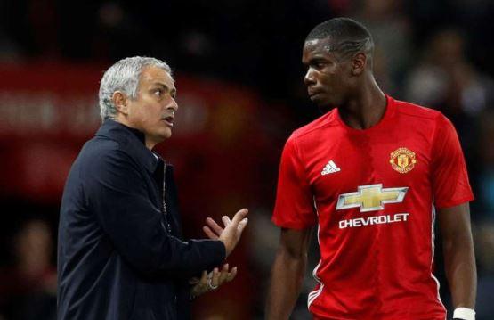 Jose Mourinho dan Paul Pogba.