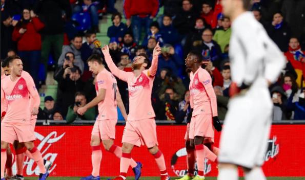 Lionel Messi usai membobol gawang Getafe di Stadion Coliseum Alfonso Perez, Spanyol, Senin (7/1) pagi WIB.