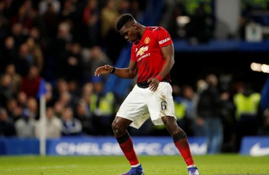 Paul Pogba lakukan selebrasi usai cetak gol ke gawang Chelsea.
