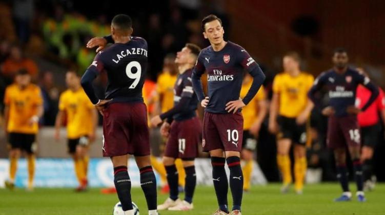 Para pemain Arsenal lesu usai dipermalukan Wolves 3-1.(Foto: Andrew Boyers/Reuters)