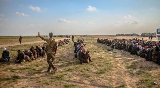 Ilustrasi anggota ISIS yang menyerah setelah kekhalifahan mereka kalah.