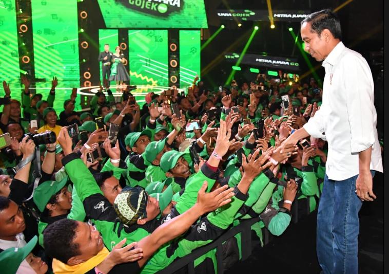 Presiden Joko Widodo saat hadir dalam acara Mitra Juara Gojek 2019 yang digelar di Econvention Ancol, Jakarta, Kamis, 11 April 2019.