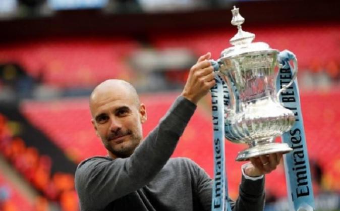 Pelatih Manchester City Pep Guardiola sukses merengkuh tiga gelar juara di Inggris.