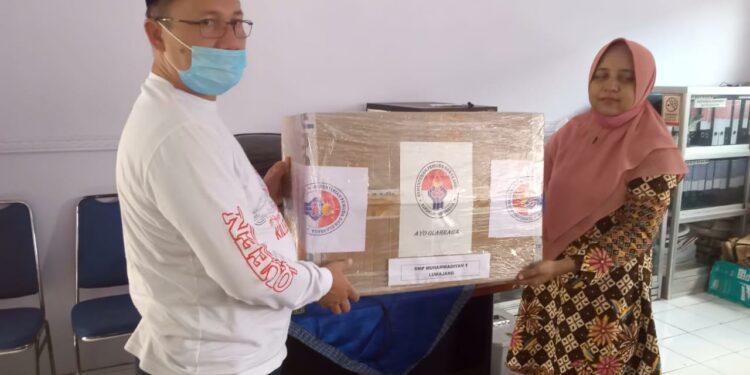 Purnamasidi memberikan bantuan bekerjasama dengan Kementrian Pemuda dan Olah Raga.